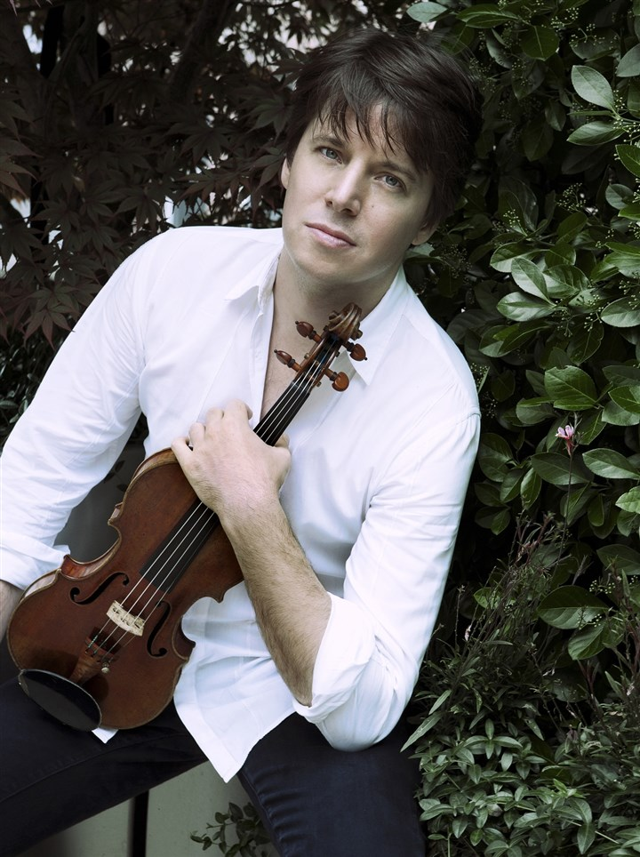 "20140225hopsobellmag Joshua Bell gave a colorful reading of Lalo's five-movement violin concerto, ""Symphonie Espagnole,"" with the Pittsburgh Symphony Friday."