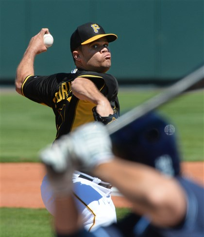 20140301pdPiratesSports01-4 Pirates starter Wandy Rodriguez delivers against the Rays Saturday afternoon at McKechnie Field Bradenton, Fla.