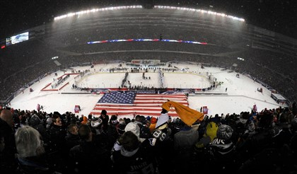 Fans stand for the national anthem Fans stand for the national anthem before the start of the Penguins-Blackhawks game Saturday night at snow Soldier Field in Chicago.