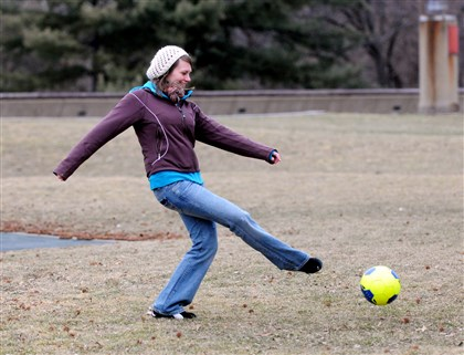 20140301ttSoccerLocal-15 Jana Blach of the North Side takes advantage of the mild weather Saturday afternoon to practice soccer in Schenley Park.