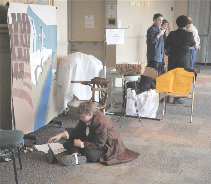 20140301ttHistoryLocalWeb Ethan Schroeder, 12, of Tarentum, a sixth-grader at Mary, Queen of Apostles School in New Kensington, checks his information before a performance as Dr. Ignaz Semmelweis, a 19th century Hungarian physician who was a pioneer of antiseptic policy.