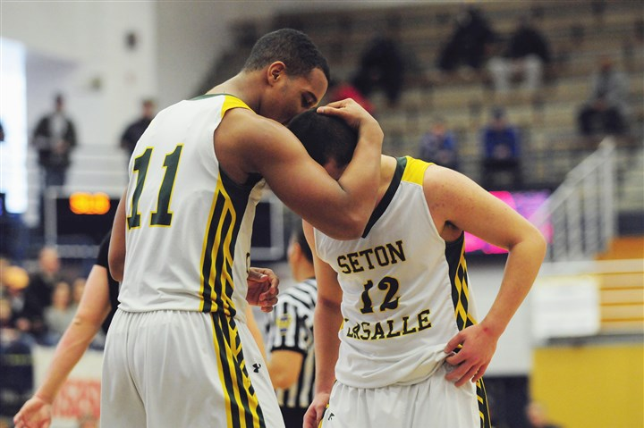 seton0302a Seton-LaSalle's Malik White embraces teammate Christian DelGreco after winning the WPIAL Class AA title Saturday at Palumbo Center.