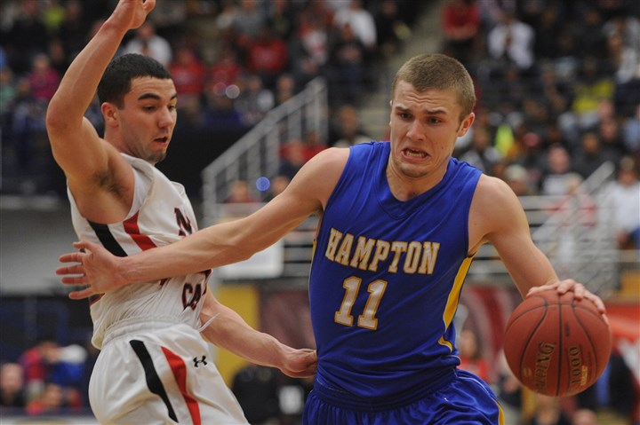 cluther0302 Hampton's Collin Luther drives around New Castle's Anthony Richards Saturday night in the Class AAAA boys title game at Palumbo Center.
