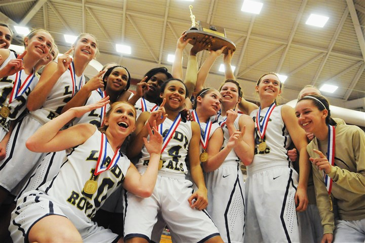 vincentian0302 Vincentian players hoist their trophy after defeating the Serra Catholic Eagles in the WPIAL Class A final Saturday at Palumbo Center.