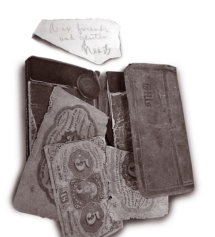 NextPage_Stephen_Foster3-2 Foster's wallet with a scrap of his handwriting.