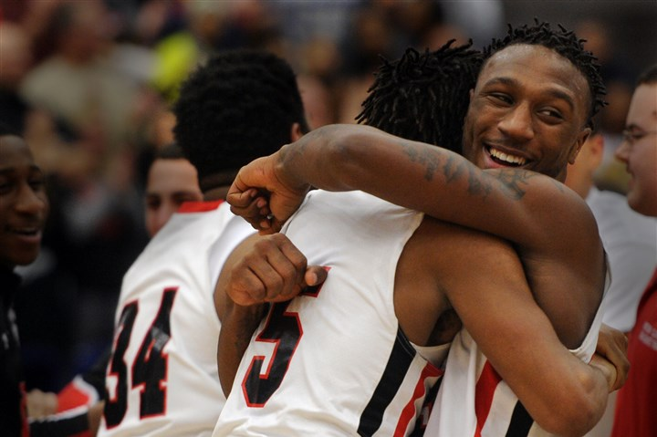 hooker0302 New Castle's Malik Hooker celebrates with teammate Jake McPhatter after beating Hampton to win a WPIAL championship for the third season in a row.