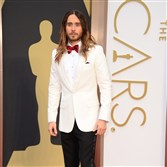 "Jared Leto, shown at the 2014 Adacemy Awards, has shorn his long locks in preparation for his next role at The Joker in the ""Suicide Squad."""