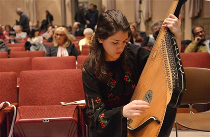 "20140302lrukrainelocal02-1 Christina Hlutkowsky runs through Hryhoriy Kytasty's ""Song of the Steppes"" which she played on the bandura, a Ukrainian national instrument, during ""A Tribute to Ukraine"" on Sunday at the Frick Fine Arts Center."