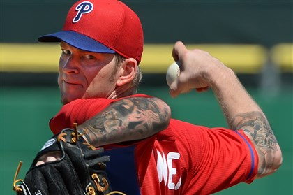 burnett0303 Phillies pitcher A.J. Burnett delivers to his former team Sunday afternoon in Clearwater, Fla.