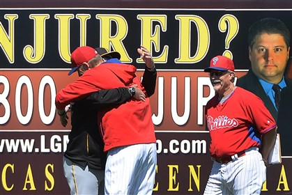 burnettsearage0303 Phillies pitcher A.J. Burnett hugs his former pitching coach, Ray Searage, in the outfield before taking the mound Sunday against the Pirates in Clearwater, Fla.