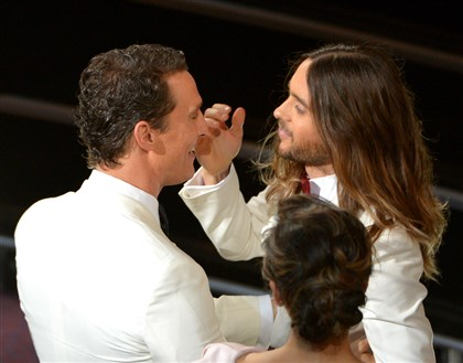 "20140302oscars1 Matthew McConaughey, left, congratulates Jared Leto during the Oscars at the Dolby Theatre in Los Angeles. The former won best actor and the latter best supporting actor for their work in ""Dallas Buyers Club."""