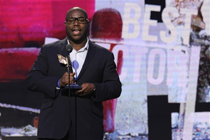 "20140303APSpirit2-1 Steve McQueen accepts the award for best director for ""12 Years a Slave"" at the 2014 Film Independent Spirit Awards Saturday in Santa Monica, Calif."