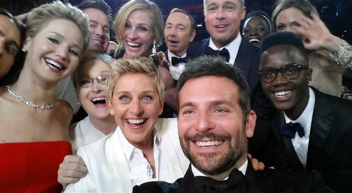 "20140303selfie_twitter This image released by Ellen DeGeneres shows actors front row from left, Jared Leto, Jennifer Lawrence, Meryl Streep, Ellen DeGeneres, Bradley Cooper, Peter Nyong'o Jr., and, second row, from left, Channing Tatum, Julia Roberts, Kevin Spacey, Brad Pitt, Lupita Nyong'o and Angelina Jolie as they pose for a ""selfie"" portrait on a cell phone during the Oscars. (AP Photo/Ellen DeGeneres)"