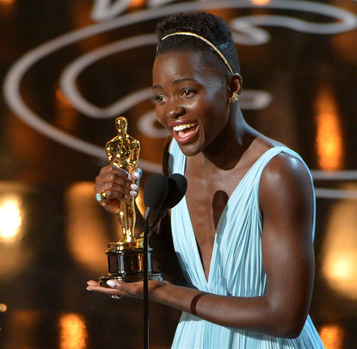 "20140303Lupita3_Oscars Lupita Nyong'o accepts the award for best actress in a supporting role for ""12 Years a Slave,"" which won best picture at the 86th Academy Awards."