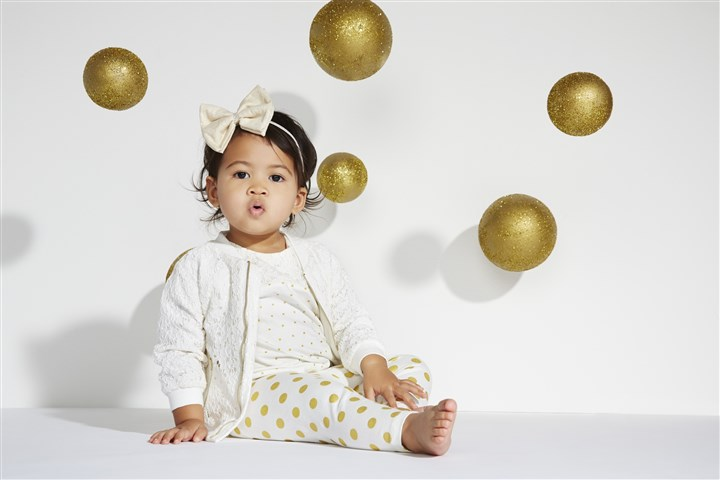 "20140228hostyleb0303-6 Kim, Kourtney and Khloe Kardashian have designed a collection of children's clothes for Babies ""R"" Us that will launch in mid-March."