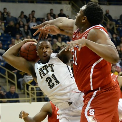Lamar Patterson Lamar Patterson's shot is blocked by North Carolina State's Beejay Anya Monday night at Petersen Events Center.