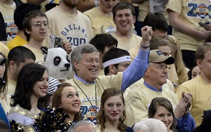 20140303mfpittsports05-4 Pitt chancellor Mark Nordenberg stands with the Oakland Zoo as the team takes on NC State March 3 at the Petersen Events Center.
