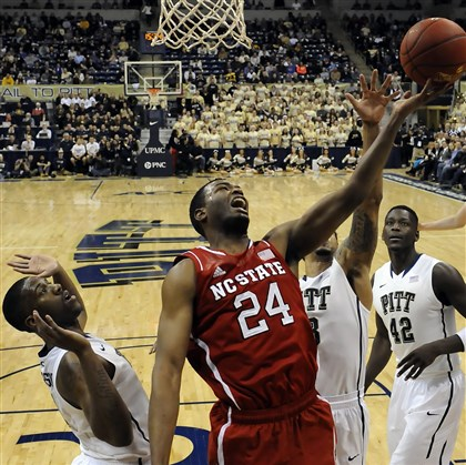 20140303mfpittsports09 North Carolina State forward T.J. Warren drives to the net against Pitt players Monday night at the Petersen Events Center.