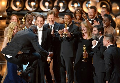 "APTOPIX 86th Academy Awards - Show Director Steve McQueen, left, celebrates with the cast and crew of ""12 Years a Slave"" as they accept the award for best picture during the Oscars."