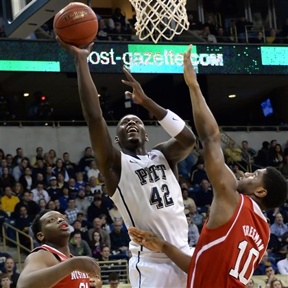 20140303mfpittsports03-2 Pitt's Talib Zanna drives to the net against NC State's Beejay Anya and Lennard Freeman in the first half Monday night at the Petersen Events Center.