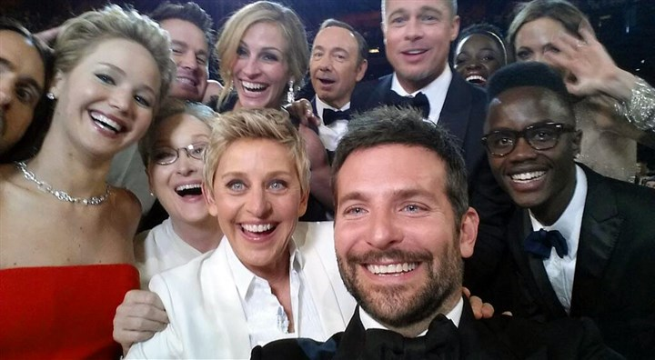 "86th Academy Awards selfie This image released by Ellen DeGeneres shows actors front row from left, Jared Leto, Jennifer Lawrence, Meryl Streep, DeGeneres, Bradley Cooper, Peter Nyong'o Jr., and, second row, from left, Channing Tatum, Julia Roberts, Kevin Spacey, Brad Pitt, Lupita Nyong'o and Angelina Jolie as they pose for a ""selfie"" portrait on a cell phone during the Oscars."