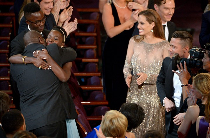 "86th Academy Awards - Show Steve McQueen, left, and Lupita Nyong'o celebrate in the audience after ""12 Years a Slave"" is announced as winner of the award for best picture of the year during the Oscars."