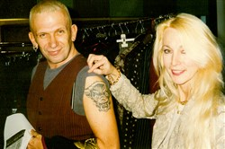 Karin Legato of Emphatics takes a picture with designer Jean Paul Gaultier in 1994.