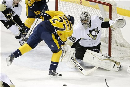 Penguins-Predators Penguins goalie Marc-Andre Fleury blocks a shot by Nashville forward Patric Hornqvist in the first period.