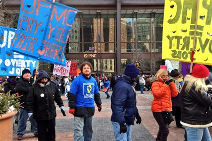Protesters gather in the U.S. Steel Tower plaza Protesters gather in the U.S. Steel Tower plaza to call upon UPMC for higher wages, the right to unionize and other demands.