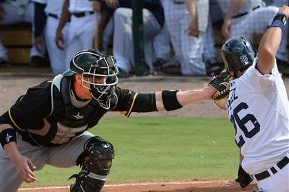 20140304pdPiratesSports07-6 Pirates catcher Chris Stewart, left.