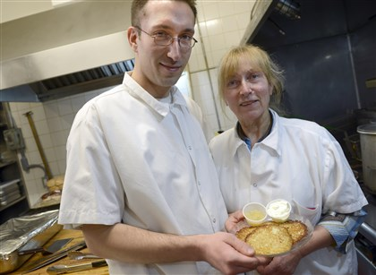 20140228ppRatskeller4FOOD-2 Christopher Krasicki and his mother, Inge Horder, head chef of Teutonia Mannerchor with her specialty, potato pancakes.