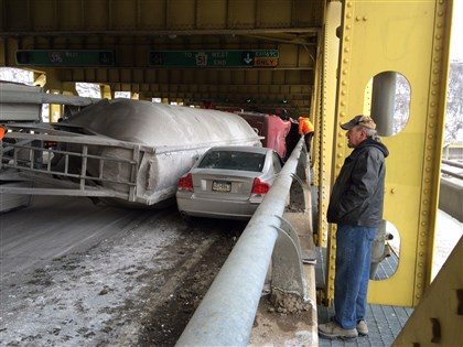 Truck crash on bridge Truck driver Will Young watches after his rig carrying dry lime overturned Wednesday morning on the outbound Fort Pitt Bridge. No one was injured.