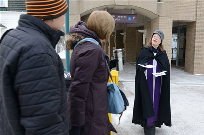 The Rev. Michelle Boomgaard offers ashes The Rev. Michelle Boomgaard, of St. Paul's Episcopal Church in Mt. Lebanon, approaches commuters about receiving ashes in front of the Mt. Lebanon T station along Washington Road.