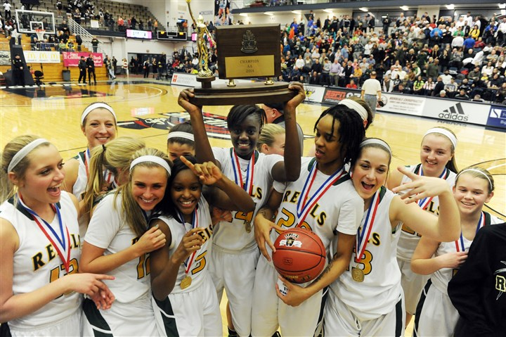 20140228bwGirlsAAzspts03 Yacine Diop hoists the WPIAL Class AA girls basketball trophy and teammate Naje Gibson displays the game ball as the Seton-LaSalle girls celebrate their championship.