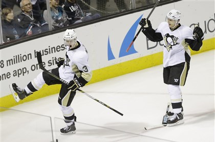 20140306pens66-1 Penguins' Olli Maatta celebrates his goal with teammate Marcel Goc during the first period against the San Jose Shark.