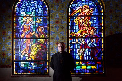 20140303MWHsakvukLocal02 The Rev. Yuriy Sakvuk, a professor at Ukrainian Catholic University in Lviv, stands inside Holy Trinity Ukrainian Catholic Church in Carnegie during a visit Monday.