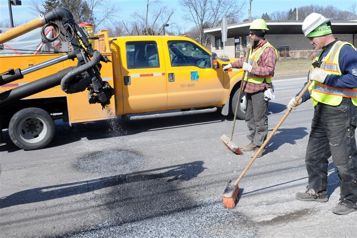Pothole Killer in McCandless A Pothole Killer shoots hot asphalt on Thursday to fill a pothole on Route 19 in McCandless as PennDOT workers Chuck Berie, left, and Mike Lonergan assist.