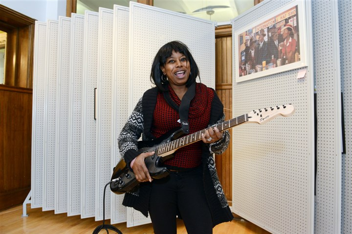 "20140305bwArtMag01 Mary Carey of Braddock, an art facilitator at The Art Lending Collection with a guitar that is the art of Sara Shaoul called ""American Technology."""