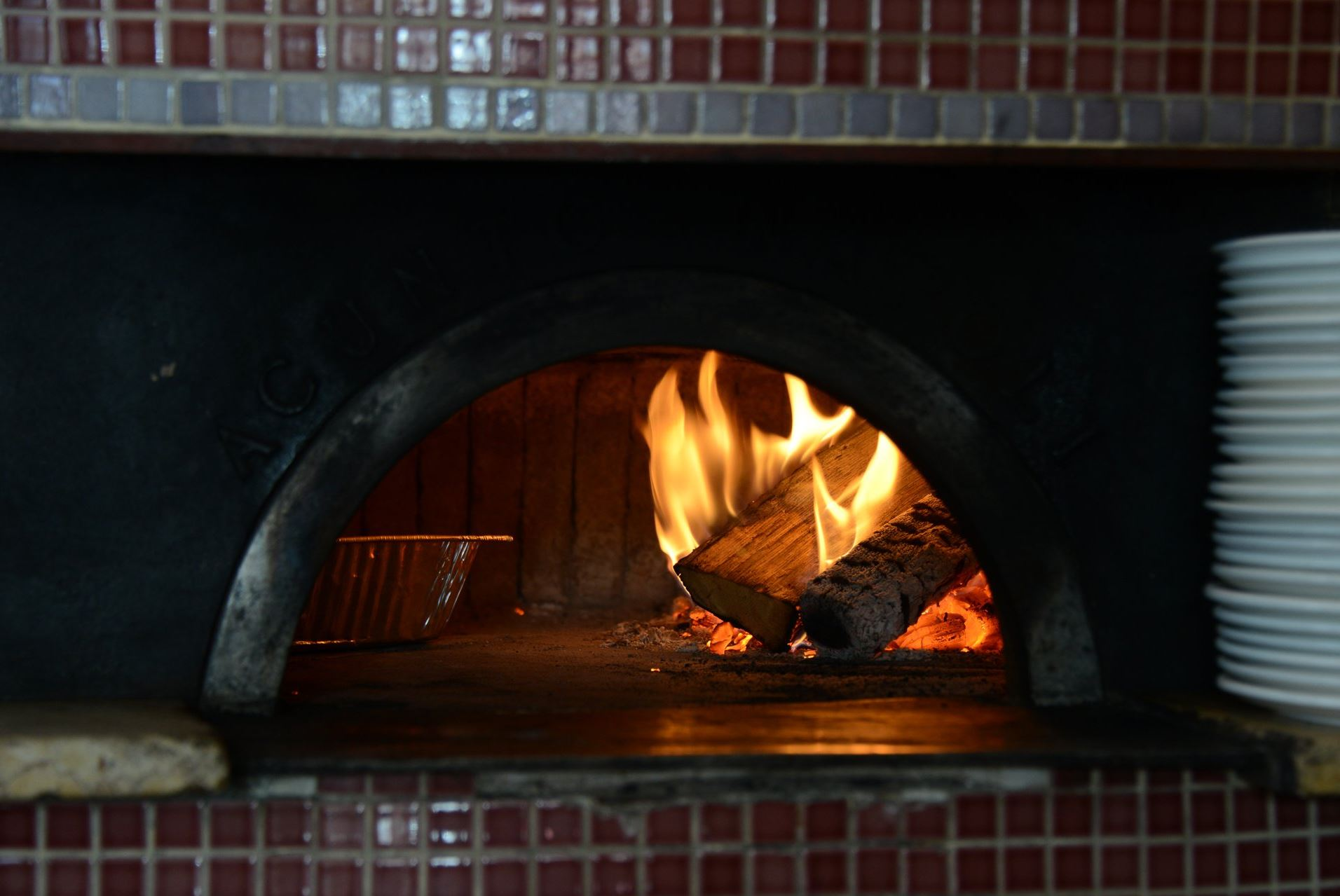 201435RARmagoven1 A fire in the wood burning oven at Piccolo Forno in Lawrenceville.