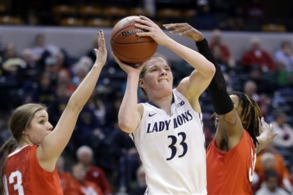 lucas0308 Penn State guard Maggie Lucas shoots between Ohio State guards Cait Craft, left, and Raven Ferguson.