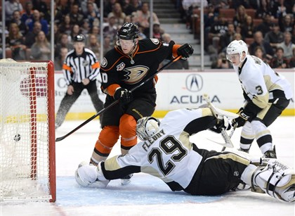 Corey Perry and Marc-Andre Fleury and Olli Maatta The Duck's Corey Perry shoots the puck past Marc-Andre Fleury to score as Olli Maatta looks on during the first period of play at the Honda Center Friday in Anaheim.