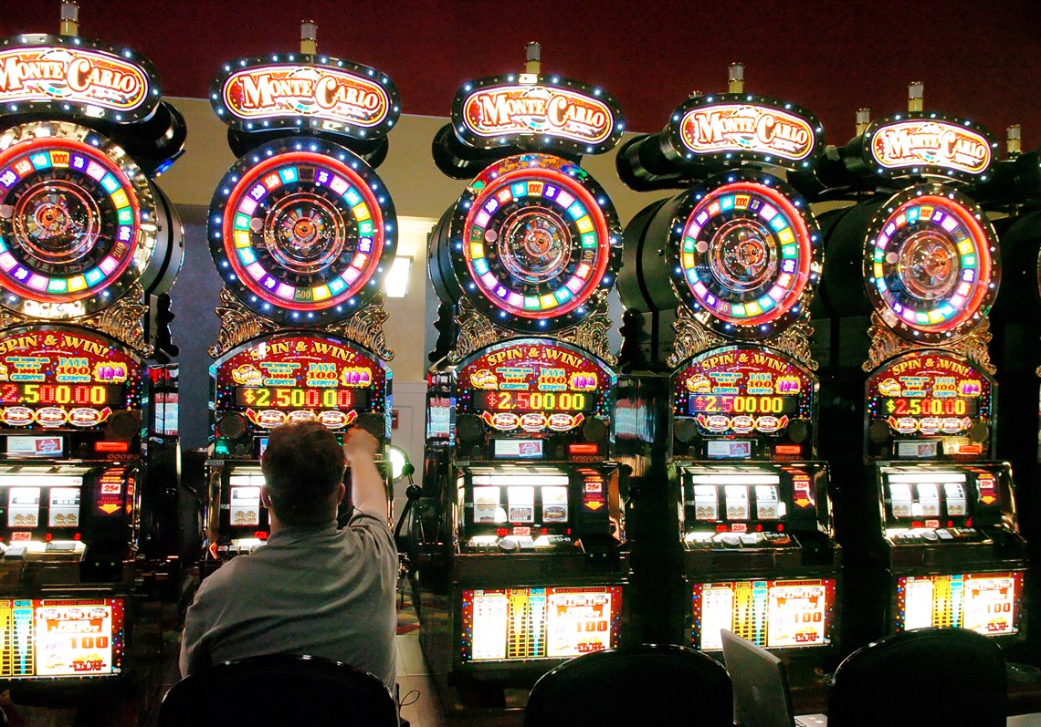 A slot technican at the Meadows Racetrack and Casino in Washington County, checks a slot. 1. Pennsylvania House OKs biggest