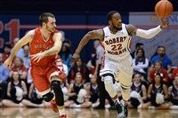 Robert Morris' Lucky Jones steals the ball against Saint Francis' Ronnie Drinnon in the first half of the NEC tournament semifinals in March.