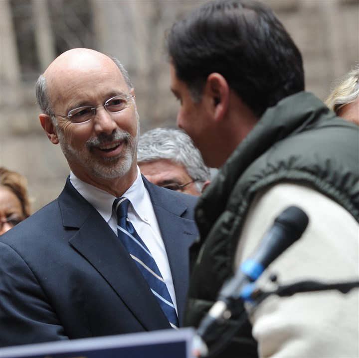 Tom Wolf with Bill Peduto Gubernatorial candidate Tom Wolf shakes hands with Pittsburgh Mayor Bill Peduto during an endorsement announcement in the courtyard of the Allegheny County Courthouse on Saturday.
