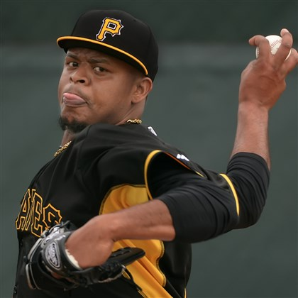 volquez0316 Pirates pitcher Edinson Volquez delivers in spring training at McKechnie Field in Bradenton, Fla.