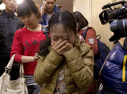 China Malaysia Plane: relative of the missing passengers A Chinese relative of passengers aboard a missing Malaysia Airlines plane, center, cries as she is escorted by a woman while leaving a hotel room for relatives and friends of passengers aboard the missing airplane.