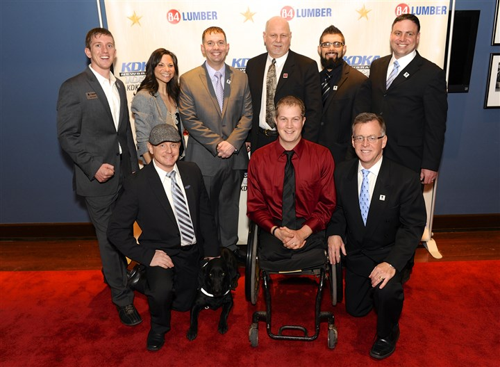 20140309HometownHeroes2-1 Wounded Warrior Project staff and alumni with Larry Richert.