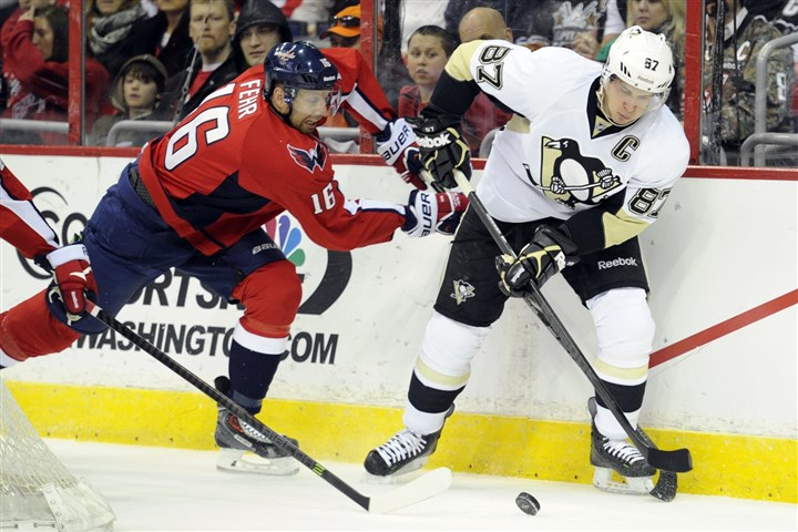 20140310penguins55 Washington Capitals right winger Eric Fehr battles Sidney Crosby for the puck.