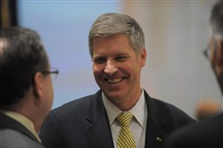 Patrick D. Gallagher talks with well-wishers after a University of Pittsburgh Board of Trustees meeting in February at which he was elected as the new Chancellor of the university.