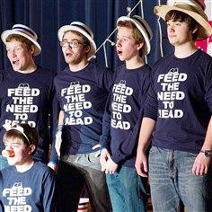 "20140311HFsfeed0320dsouth Shake-a-Leg Players perform the ""Charlotte's Web"" skit at Abraham Lincoln Elementary School. They are: Ian Maerkl, kneeling; and from left, Patrick Raymond, D.J. Miller, Cam Nickel and Wally Donnellan."